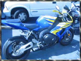 yellow and blue honda CBR