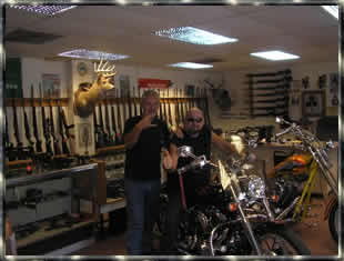 Harley Davidson at a gun shop