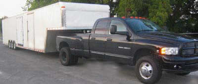 black dodge truck with enclosed trailer